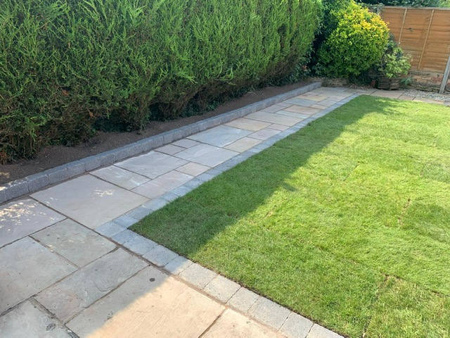 garden pathway created using stone slabs and block edging